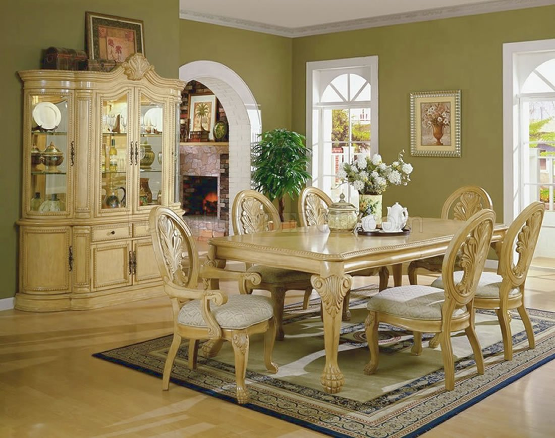 Antique white formal dining room with carving details for Formal dining room tables