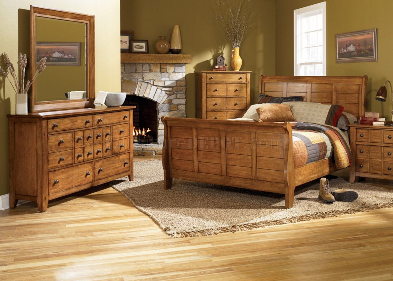 Rustic oak finish traditional sleigh bed w optional case goods Traditional rustic master bedroom