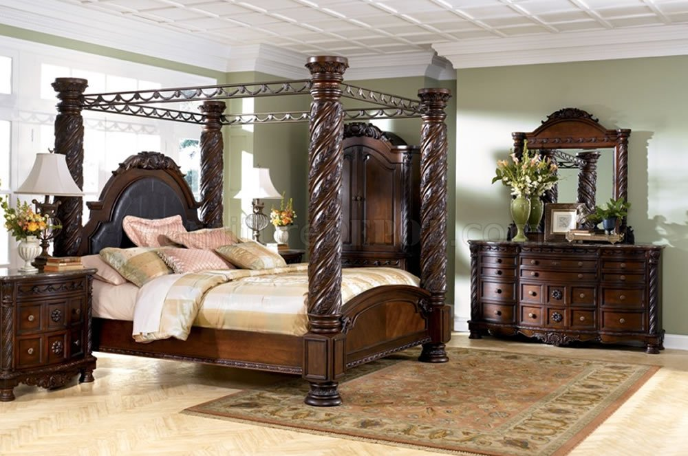 brown cherry hand carved post bed from ashley signature