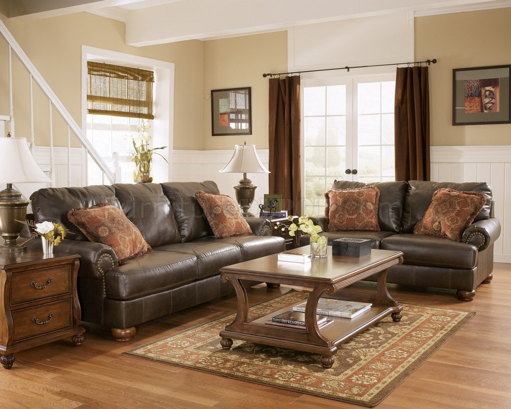 Truffle Color Rustic Living Room With Nailhead Deatils By