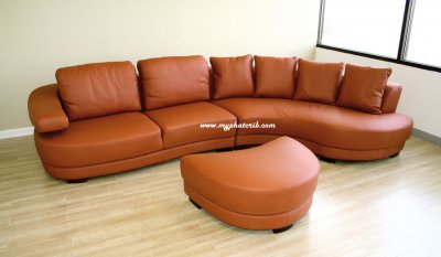 curved sectional sofa in burnt orange leather