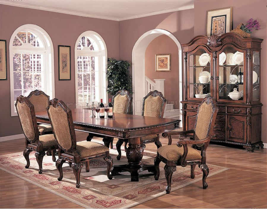 Antique style brown elegant dining room extendible table for Traditional formal dining room ideas